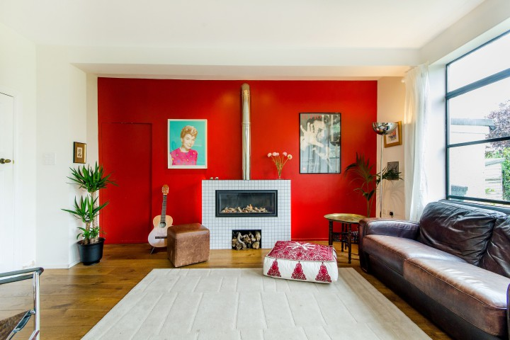 painting the wall behind your fireplace will make it stand out creating a centrepiece for the room this propertys fireplace has an exposed flu and a - Home Inspiration Ideas
